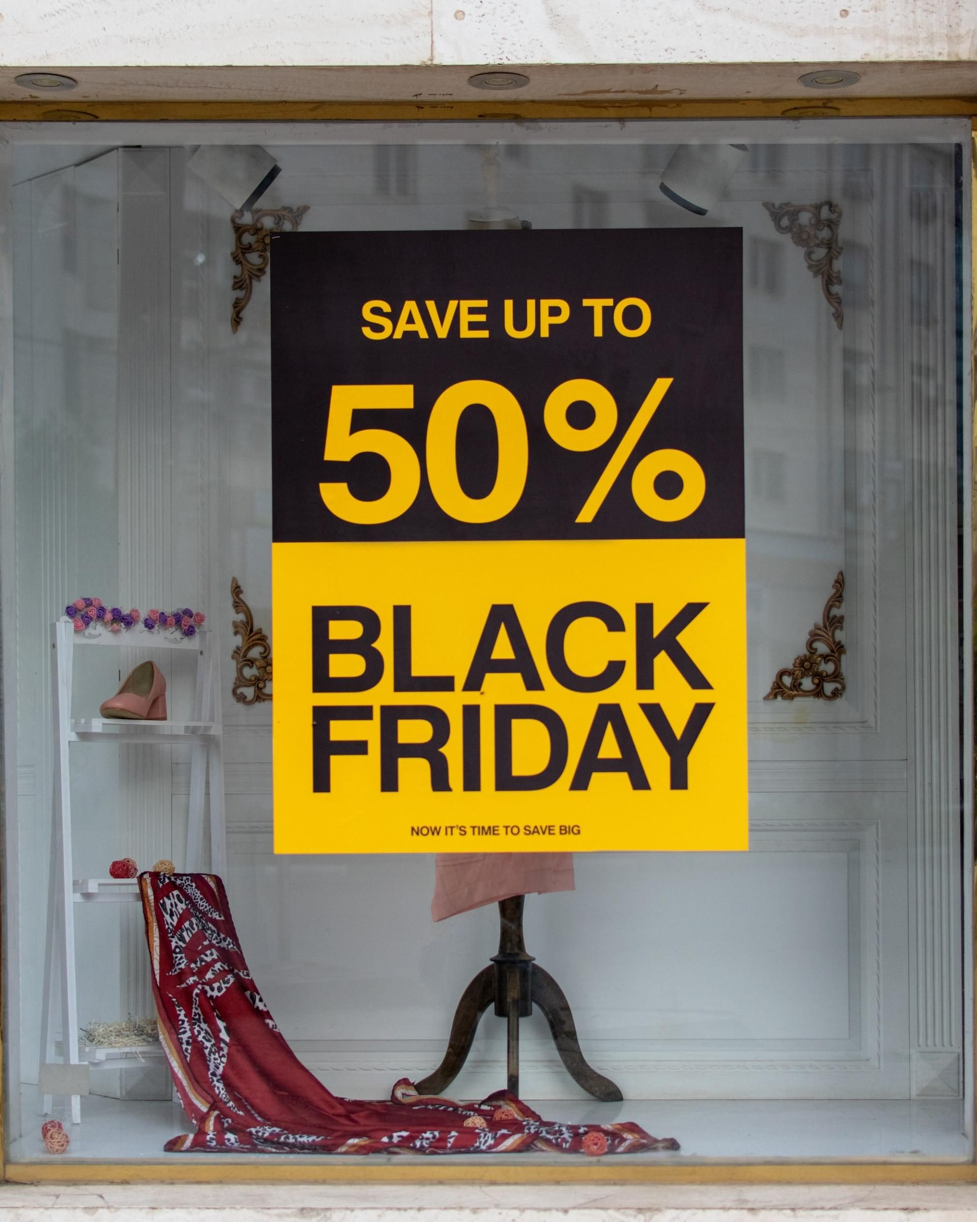 Shop front with 50% off Black Friday poster